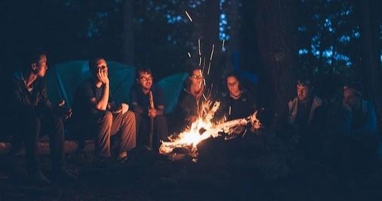 Friends around a bonfire at night